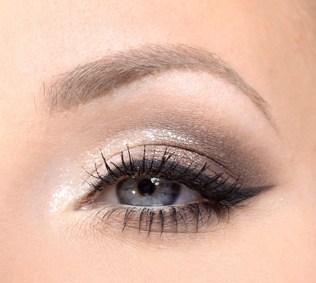 brown champagne new year make-up with eyeliner and glitter