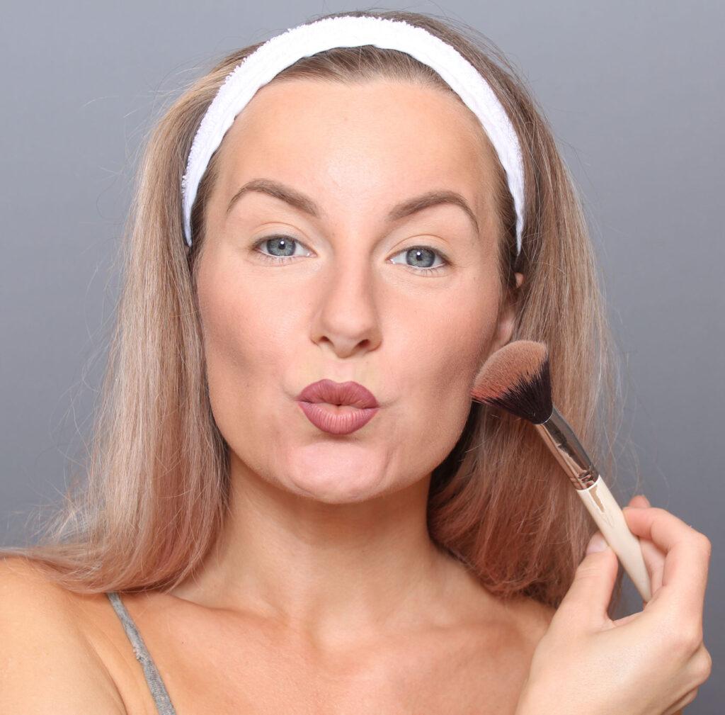 bass makeup before passport photo